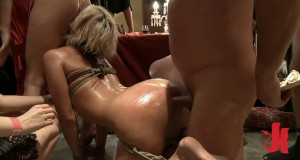 Blonde slave does a deep throat while having her ass fucked by some strange men