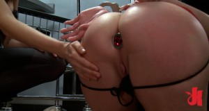 Submissive blonde slut has her ass filled with a butt plug and gets spanked for this