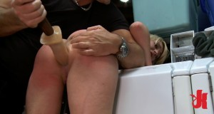 Blonde whore gets her ass brutally fucked by a giant dildo while bent over